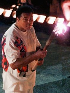 Muhammad Ali carries the torch