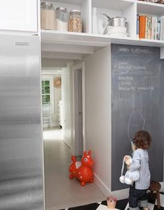 Make it a magnetic chalkboard Wall - and dustless chalk!  I also like the continued storage above the door.
