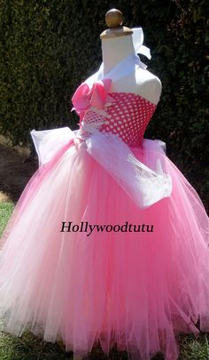 Princess Aurora,sleeping beauty tutu dress perfect for dress up,birthday parties and halloween fits sizes 2T-4T. $52.99, via Etsy.