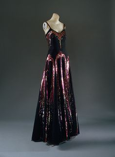 "Evening dress, 1938 by Gabrielle ""Coco"" Chanel, French. Black silk net with polychrome sequins, worn by Countess Madeleine de Montgomery to Lady Mendl's seventy-fifth birthday party in 1939."