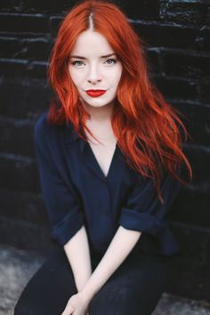 This orange red with her red hair is gorgeous!