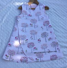 Items similar to Reversible dress, age cotton woodland / check fabrics, Twig and tail. on Etsy