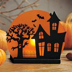 """SPOOKY HOUSE VOTIVE HOLDER : The full moon casts an eerie orange glow over our haunted Halloween house when lit by a votive or tealight, sold separately. Metal and glass; includes votive cup. 5½""""h, 4¾""""w. by PartyLite"""