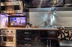 Kitchen and bar area in an ultra-modern Airstream motorhome