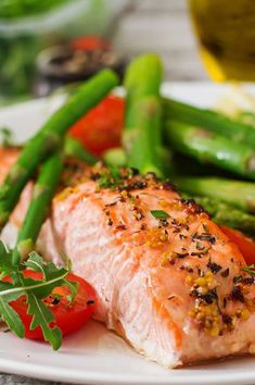 Buy Baked salmon garnished with asparagus and tomatoes with herbs by Timolina on PhotoDune. Baked salmon garnished with asparagus and tomatoes with herbs Low Carb Dinner Recipes, Healthy Recipes, Healthy Herbs, Healthy Snacks, Dieta Macros, Nordic Diet, Clean Eating, Healthy Eating, Salmon Dinner