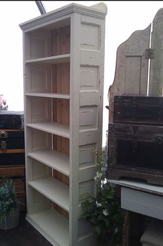 Really nice bookcase made from an old door and reused wood.