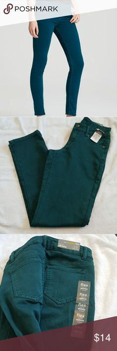 Teal Mid Rise Skinny Stretch Jeans size 1/2 Teal jeans, regular length, flex mid rise skinny jeans. Never worn.   Waist (stretch) - 26-28 inches Inseam- 30 inches Jeans Skinny