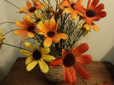 Silk flowers in clay jar by WhiskeysWhims on Etsy
