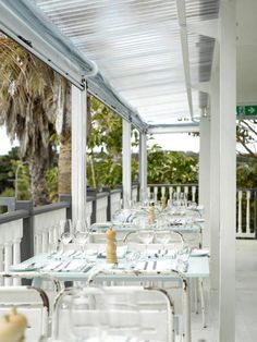 I am in love with the little metal chairs. Oyster Inn in New Zealand, Designed by Katie Lochkart, Remodelista Big Six, Waiheke Island, Auckland New Zealand, Restaurant Bar, Bayside Restaurant, Restaurant Design, Metal Chairs, Outdoor Settings, Guest Bedrooms