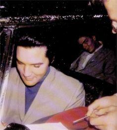 Elvis in his car in Memphis in december 9  1967 with friends.