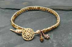 Neutral leather and tortoiseshell glass bead bracelet with wooden button £10.00