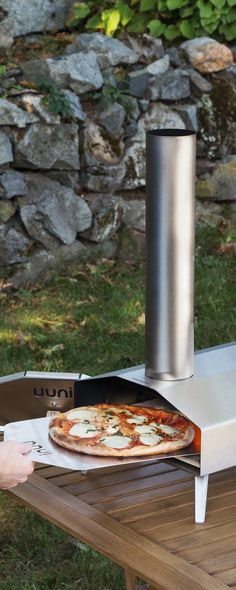 From piping hot pizzas to perfectly charred veggies and meats—this sleek oven will make it easy to wood fire like a professional.