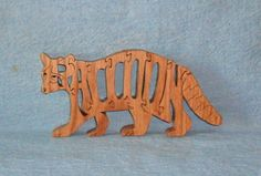 Hey, I found this really awesome Etsy listing at https://www.etsy.com/listing/85010544/raccoon-scroll-saw-wooden-puzzle