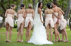 """I have a hypothesis on how this first picture happened . . .   Bridesmaid rushes out of the bathroom to get back to the photography. The second photographer sees that the bridesmaid dress is caught in her undies. To make the fool feel better they said, """"Hey, lets all do it and take a picture!"""" DUMB."""