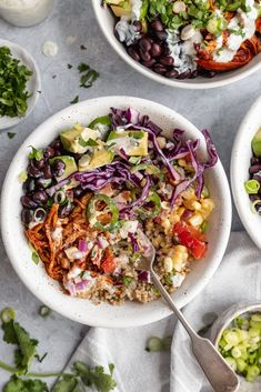 Delicious BBQ ranch chicken quinoa bowls loaded with black beans, crunchy red cabbage, sweet corn, tomato, onion, jalapeño, avocado and your choice of creamy ranch dressing. The BBQ chicken for these healthy chicken quinoa bowls can be made in the slow cooker or grilled for the perfect meal prep dinner or lunch! #quinoa #bbq #chicken #mealprep #lunch #healthylunch #dinner #glutenfree