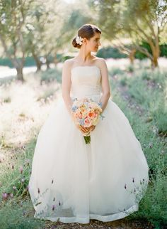 Pretty up-do with a floral hair piece.  Photo by Brandon David Photographers. www.wedsociety.com  #wedding #beauty