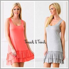 Double Ruffle Tunic Tank Dress (3 Sizes) Perfect casual summer tank dresses featuring double ruffle hemline. The can also be worn as tunic and dress extenders. Made of rayon/spandex blend. Color coral or Heather grey. Size S, M, L Threads & Trends Dresses