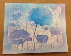 "By Jane. Artistic embossed resist that fades at the edges. Stamp negative stamp on white in VersaMark & heat emboss with clear powder. Sponge over image with purple & blue inks. Not sure how she got the fading at the edges, but I love it! Stamp is ""Poppy Background"" by Hero Arts."