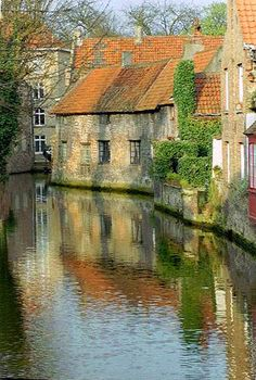 Brugge, Belgium  Have always wanted to go here!  Have a friend that makes lace and loves to watch the world's best lace makers in action in Brugge.  Maybe I'll just hitch a ride and soak up the charm of the place!
