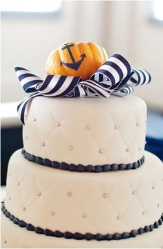 I love this wedding cake. Nautical themed with a pumpkin on top for a Fall wedding!  Could use the pumpking elsewhere for decorating.