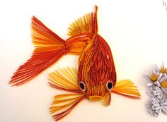 paper quilled goldfish - Quilling Cafe - Added by Maria Cvetanova on August 2012 (Gorgeous Golden Fish! Paper Quilling Tutorial, Quilled Paper Art, Paper Quilling Designs, Quilling Paper Craft, Quilling Patterns, Paper Crafts, Paper Patterns, Quilling Ideas, Kirigami