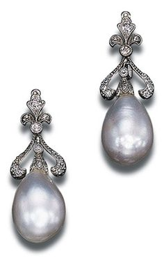 A PAIR OF ANTIQUE PEARL AND DIAMOND EAR-PENDANTS. Each set with a baroque drop-shaped pearl to the diamond-set fleur-de-lys top, circa 1910.♥≻★≺♥