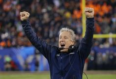 Seattle Seahawks head coach Pete Carroll reacts as Percy Harvin returns a kickoff for a touchdown during the second half of the NFL Super Bo...