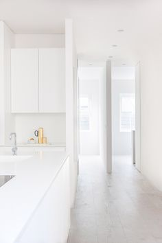 HASA Architects has transformed a dark apartment on the second floor of a three-storey Terrace in London into an all-white minimalist family home.