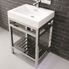 Give your bathroom an update with this single-sink bathroom vanity. The vanity's compact size makes it ideal for bathrooms with minimal square footage, and the open shelf beneath the sink gives you space to stack towels or store bathroom essentials. Industrial Bathroom Vanity, 24 Inch Bathroom Vanity, Small Bathroom Vanities, Modern Bathroom, Bathroom Ideas, Basement Bathroom, Small Bathroom Sink Cabinet, Single Vanities, Bathroom Designs