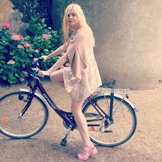 Elle Fanning & bicycle