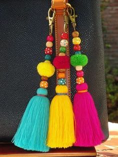 Tassel borla Pom Bag Charm ** Colorful Keychain/bag charm is handmade. ** Attach to a purse, straw bag or tote Items similar to Tassel Pom Pom Keychain Bag Charm - Zipper Pull - BOHO Chic - Wooden Beads - Pink Aqua Yellow tassels - Green Red Pompom on Ets Pom Pom Crafts, Yarn Crafts, Diy And Crafts, Arts And Crafts, Wood Crafts, Diy Tassel, Tassels, Pom Pom Bag Charm, Diy Keychain