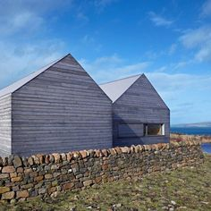 Dualchas Architects used Scottish stone and larch to build this single-storey house on the Isle of Skye, a Scottish island in the Inner Hebrides.