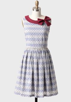 Hallie Striped Chambray Dress By Knitted Dove 99.99 at shopruche.com. An adorable burgundy bow adorns this pale blue chambray striped dress featuring textured burgundy accents. Perfected with a voluminous skirt and a hidden back zipper closure, this charming dress pairs well with flats or wedges...