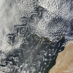Image credit: NASA This May 20 satellite image shows several cloud patterns swirling downwind of the Canary Islands. These cool patterns are called Von Kármán vortices.