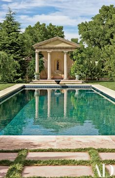 When Siri Hari Kaur Angleton-Khalsa, working with landscape architect Edith Katz, planned the swimming pool and its surroundings for her estate in New Mexico, she drew on memories of her grandmother's pool in Arizona | archdigest.com