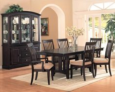 Dining Room Cream Carpet With Black Dining Set Also Chrome Candle Holder And Flower Vase Besides Orchid Green Plant Curio Cabinet Ceramic Plate Wine Painting Glass Door Curtain Some Advance Plans for Designing and Choosing Your Dining Room Furniture