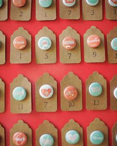 This couple affixedbuttons printed with guests' names to stamped card-stock cutouts and pinned them to a snappy red board.