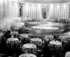 THE MOVIE SETS OF MGM,  The set above is also from Born to Dance, showing the stunning dinner club. Art Deco sets made the most not only of staircase designs but also of moderne balustrades. If you look carefully you can see a grip holding a board showing the director's name: Del Ruth, with the film's production number 934, and a date of August 10 (1936).