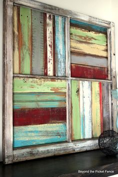 She painted random pieces of scrap wood, trim pieces, pallet wood and attached in different directions inside an old window frame. Description from pinterest.com. I searched for this on bing.com/images