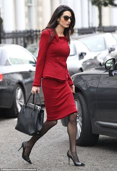 True professional: Amal, 37, cut a conservative figure as she stepped out in chic red co-ords to supportdeposed Maldives presidentMohamed Nasheed