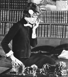 Marie-Hélène Arnaud with books in Coco Chanel's apartment wearing her black suit accented with white cuffs, bow and white camellia in her hair. Photo by Yurek. At 24 she. Style Coco Chanel, Coco Chanel Fashion, Mode Chanel, Chanel Vintage, Vintage Beauty, Vintage Fashion, Vintage Vanity, 1950s Fashion, High Fashion