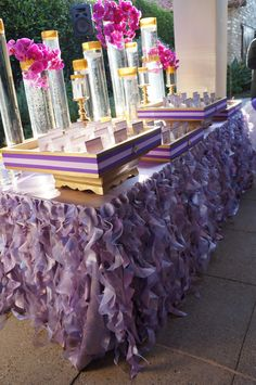 Creative Escort Card Table Idea - Curly Willow Ruffles table linen in lavender and purple tones
