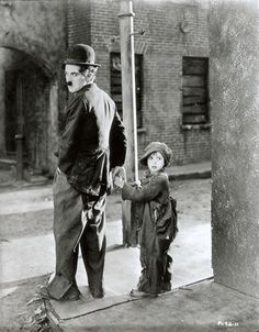 Charlie Chaplin and Jackie Coogan for 'The Kid', Charles Chaplin Productions.  Unidentified photographer, 1921.