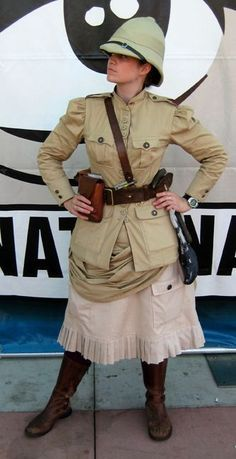 A Female Steampunk Explorer with a British Pith Helmet, Khaki Jacket, Leather Strappings and Boots. Viktorianischer Steampunk, Steampunk Cosplay, Steampunk Clothing, Steampunk Fashion, Steampunk Female, Steampunk Necklace, Gothic Fashion, Steampunk Outfits, Steampunk Theme