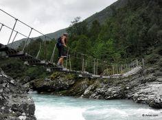 Crossing dangerous river. (Jotunheimen, Norway)