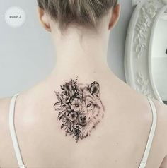 Wolf with flowers tattoo neck