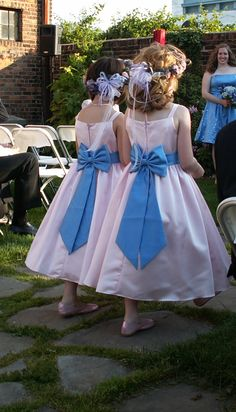 Great way to coordinate all the females in the wedding by adding a sash to the flower girls dresses that is the same color as the bridesmaids dresses