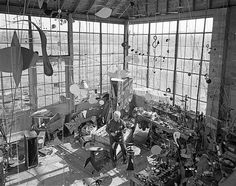 Image: Sculptor Alexander Calder uses sheets of tin, steel and lengths of wire for his mobile sculptures in his Roxbury, Conn., studio in 19...