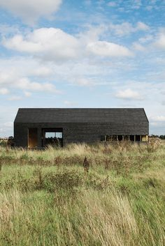 """""""It only cost about $48,000 to build, which was incredibly cheap,"""" says Turner of the Stealth Barn. """"We got the Timber Frame Company to supply the shell, then we clad it and fitted out the interior and windows ourselves. The idea was to take the archetypal black tar-painted agricultural building and make an almost childlike icon of that."""" Photo by: Christoffer Rudquist"""