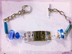 "Hand stamped and beaded  ""Believe"" bracelet with blue beads.  $35  www.sonyapaz.com"